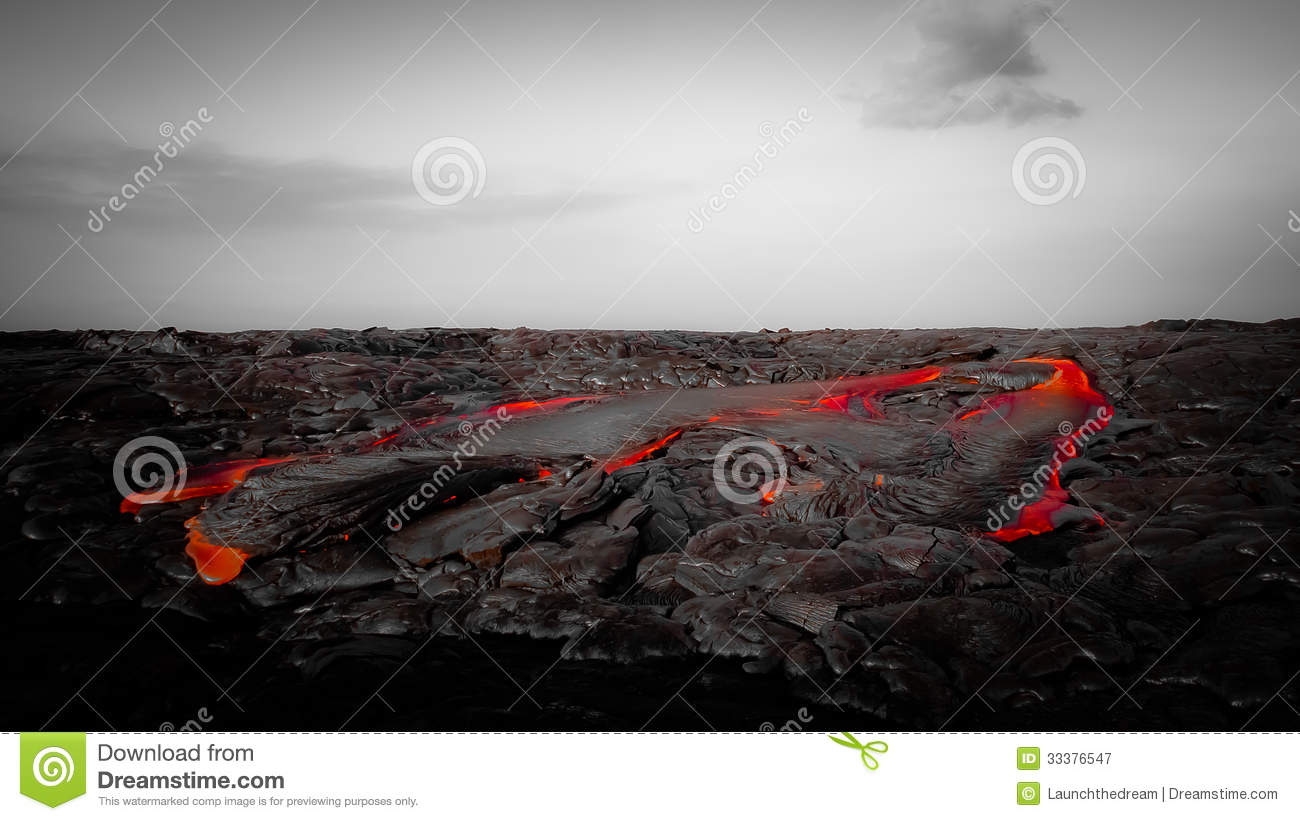 Intense Red Lava Flow In Barren Landscape Royalty Free
