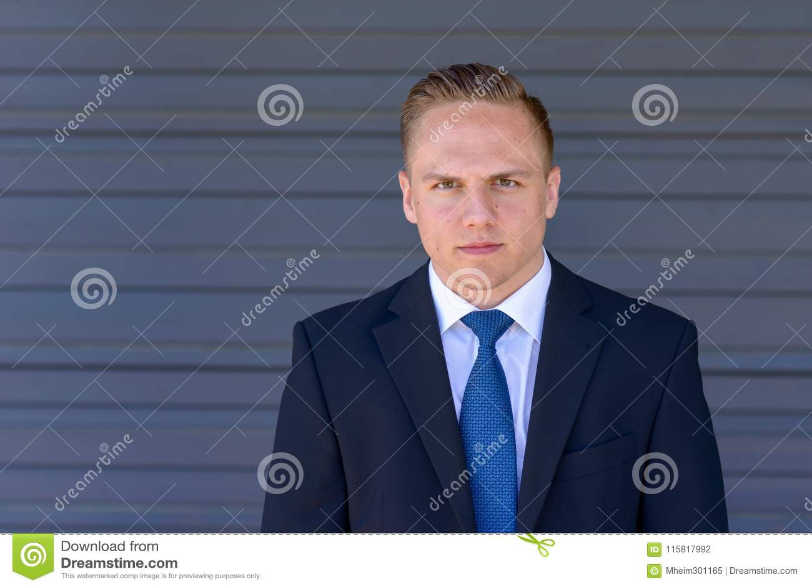 Intense Young Businessman Staring At Camera Stock Photo