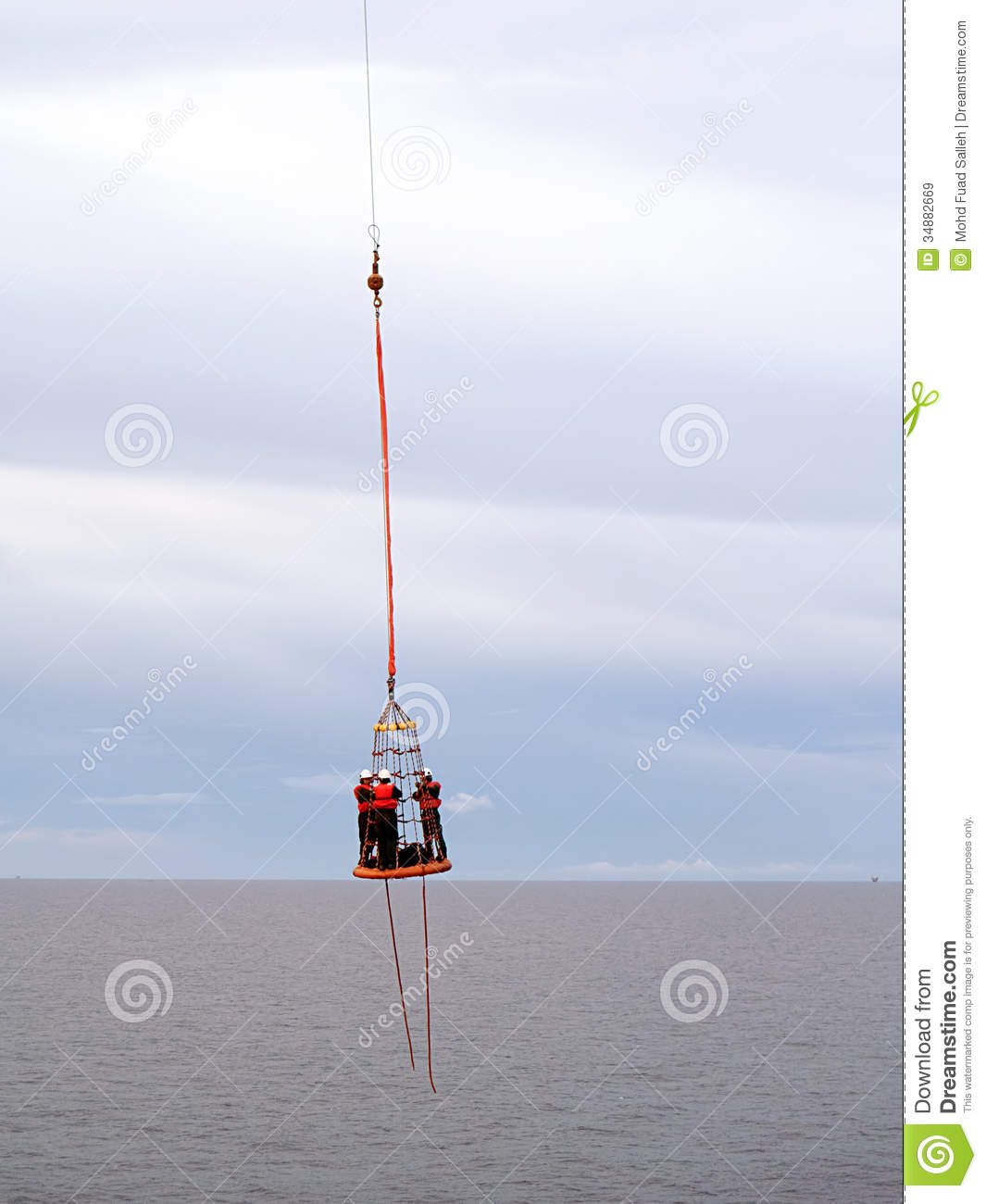 Photo of offshore oil or gas rig personnel being transfer via transfer ...
