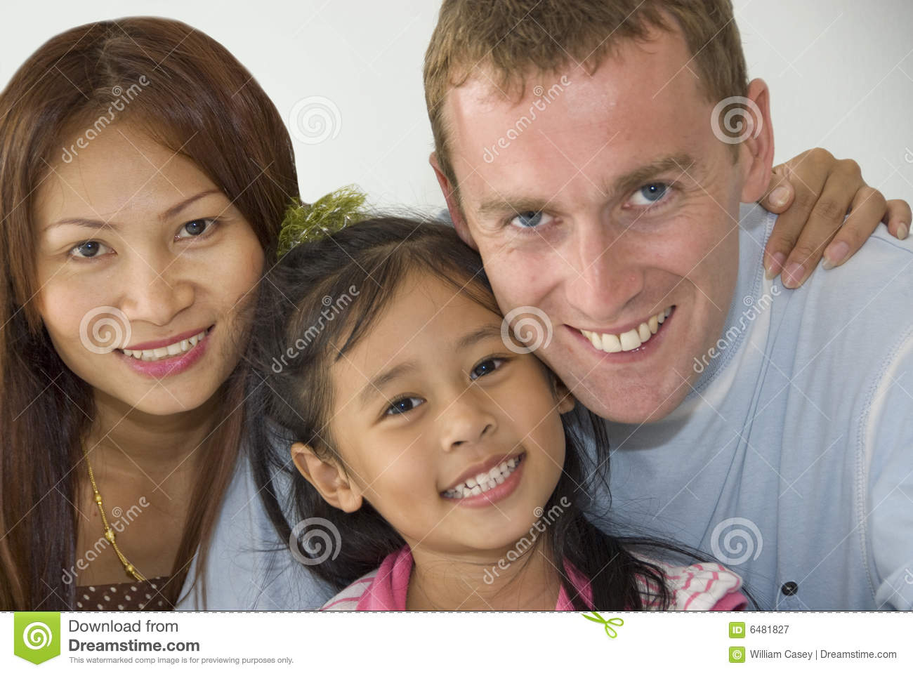 Interacial Pretty interacial family of three stock image. image of father - 6481827