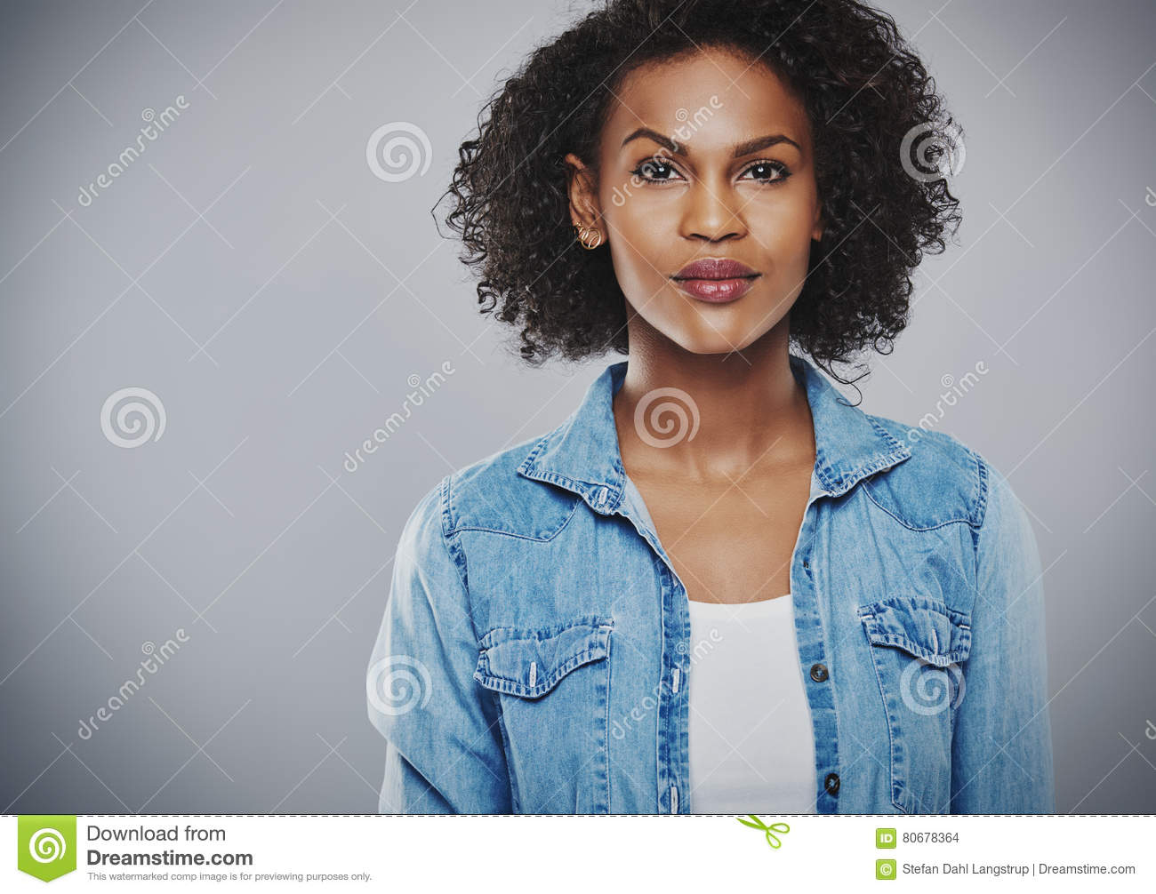 Download Interested Black Woman With Blue Jean Shirt Stock Photo - Image of intrigued, jacket: 80678364