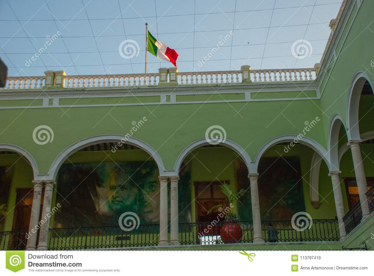interior with arches paintings and green walls city town hall of