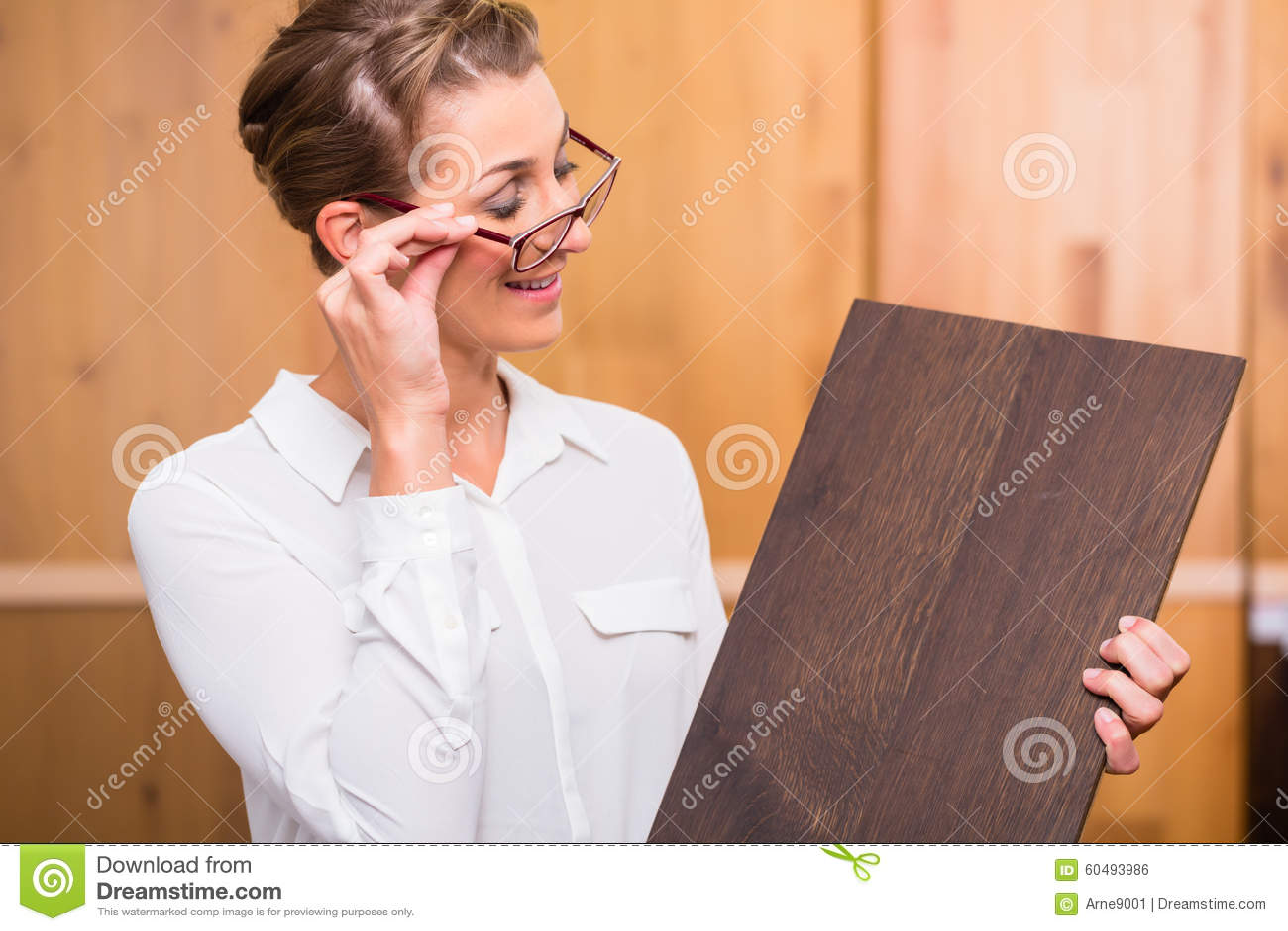 Interior architect choosing parquet wood floor