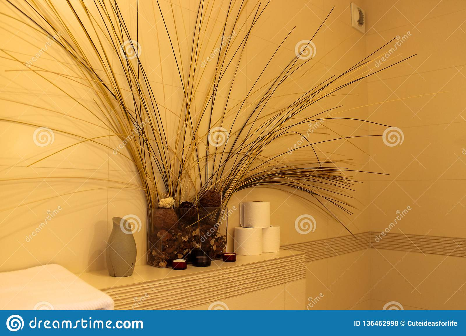 Interior of the bathroom composition of dried flowers
