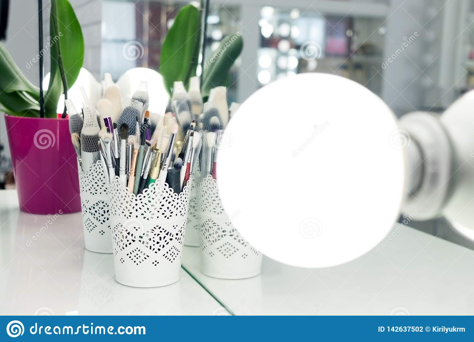 Interior Of A Beauty Salon Room With Makeup Mirror Lights And Black Chair Stock Photo Image Of Illuminated Bulb 142637502