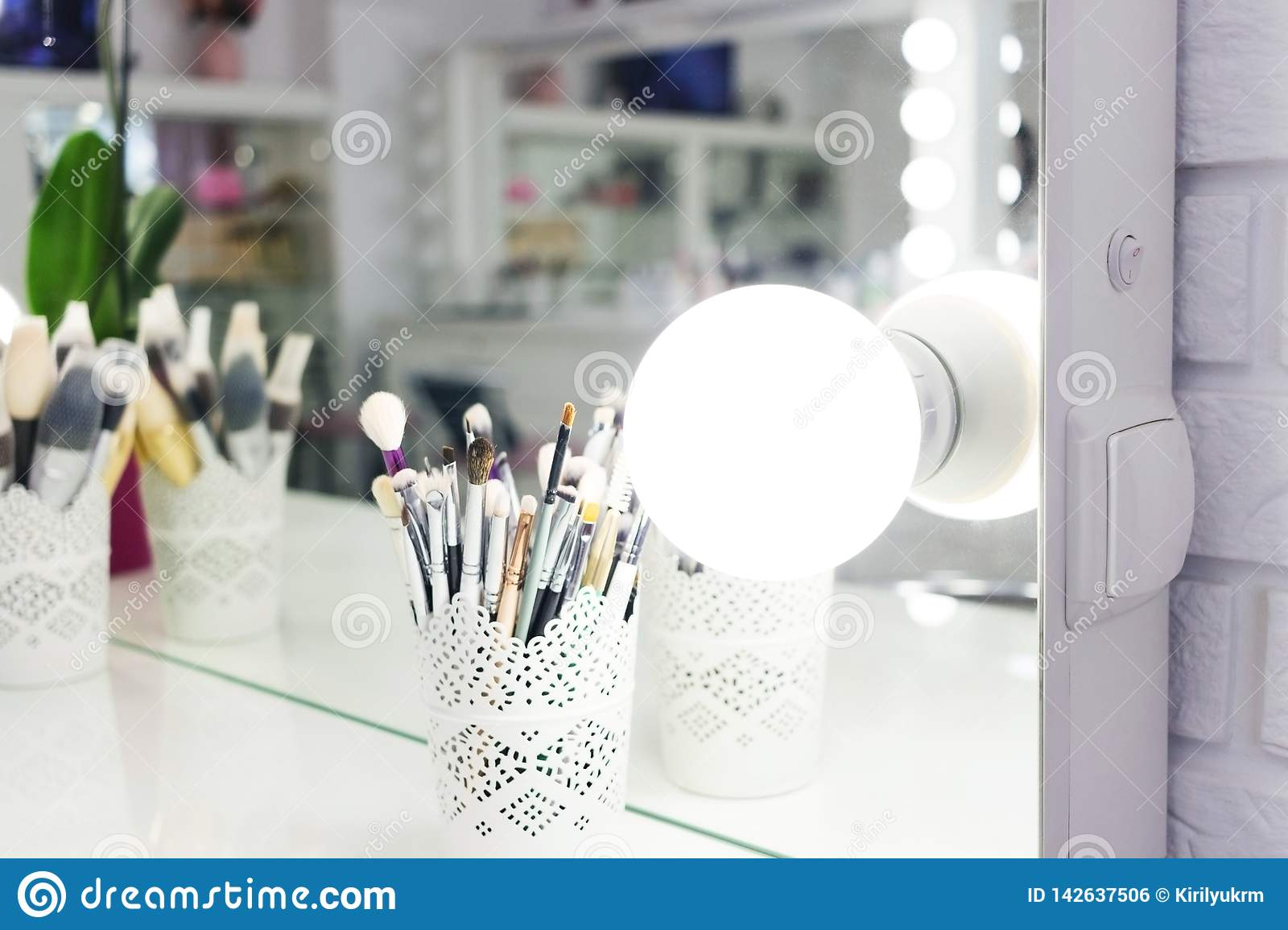 Interior Of A Beauty Salon Room With Makeup Mirror Lights And Black Chair Stock Photo Image Of Room Bulb 142637506