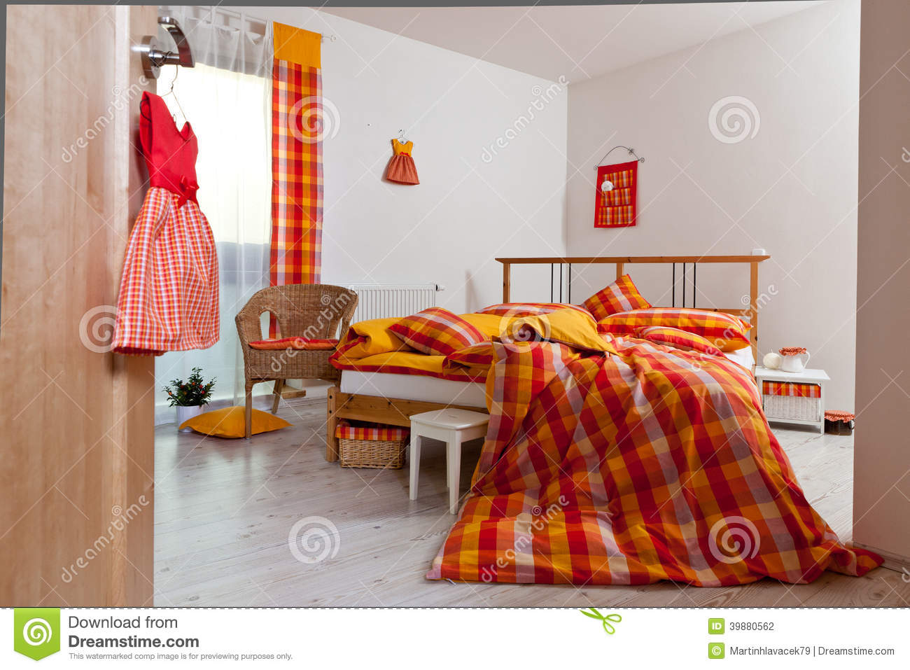 Interior Of Bedroom Bedding In Orange Yellow Red And