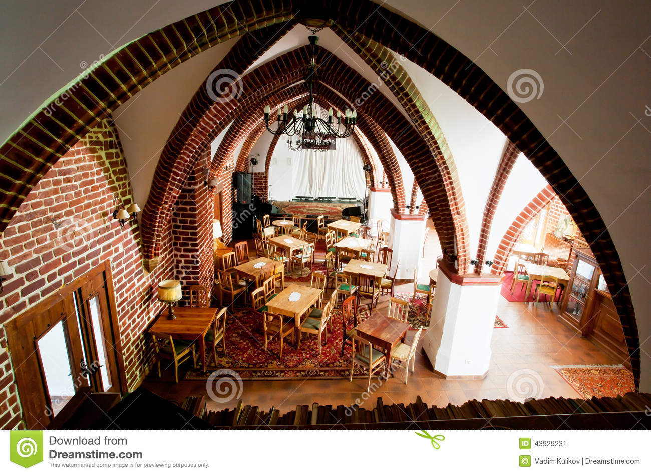 interior of cafe in the old catholic church with brick walls