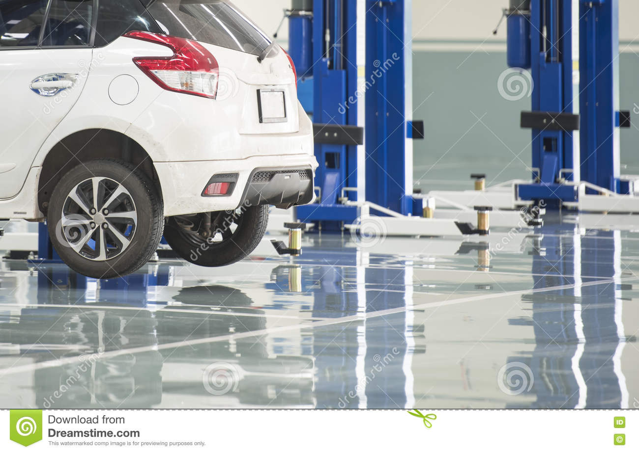 Interior Car Care Center The Electric Lift For Cars In The Service Center Stock Photo Image Of Epoxy Construction 78349448