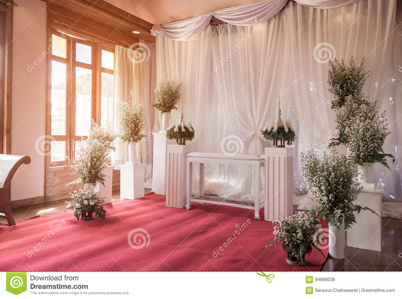 Interior ceremony wedding room decoration by red carpet for Wedding interior decoration images