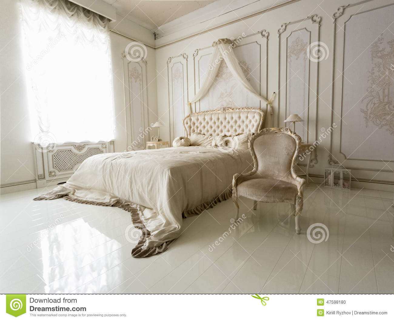 interior of classic white bedroom with big bed and chair stock photo