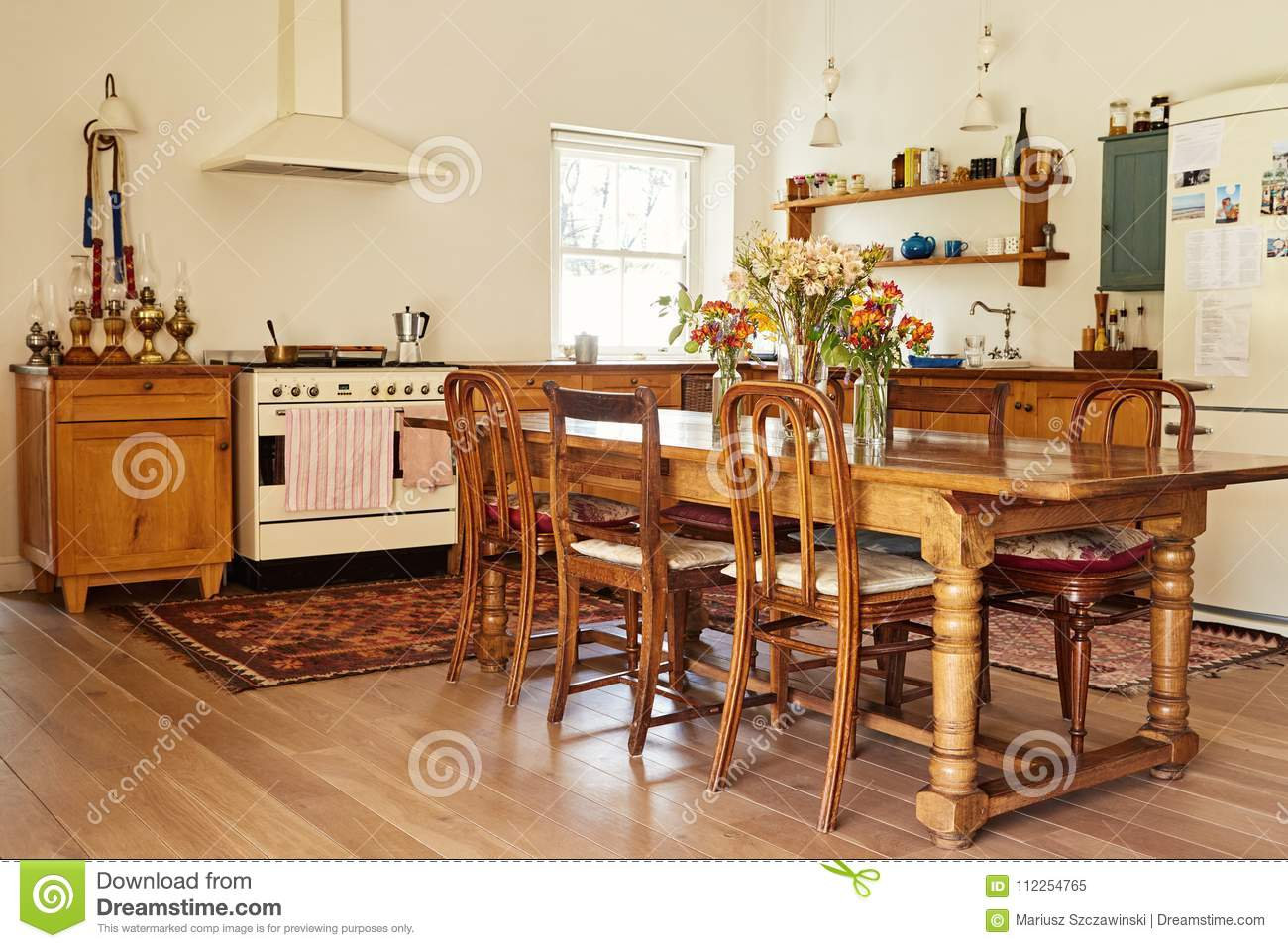 Picture of: Dining Area And Kitchen In A Country Style Home Stock Image Image Of Cupboard Decor 112254765