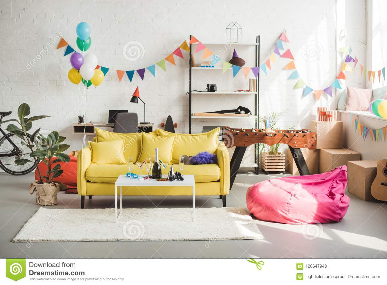 Interior of cozy room decorated with balloons and garland