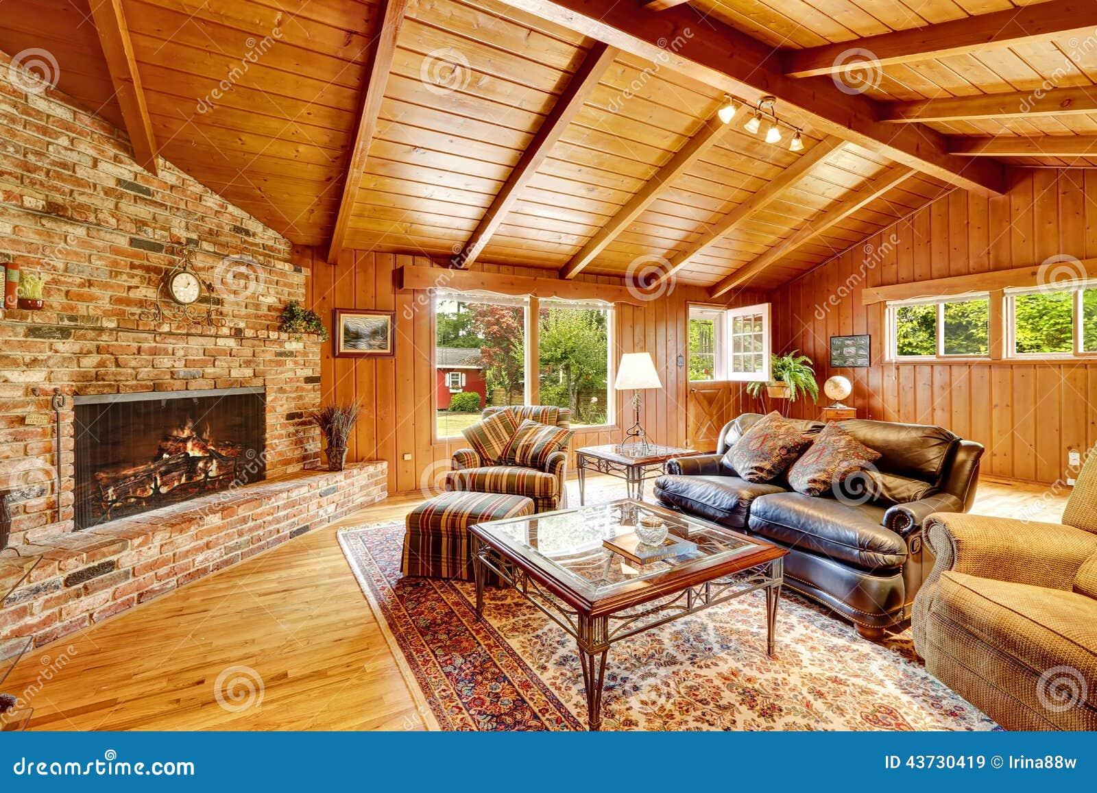 Interior de lujo de la casa de la caba a de madera sala de for Sala de estar de madera