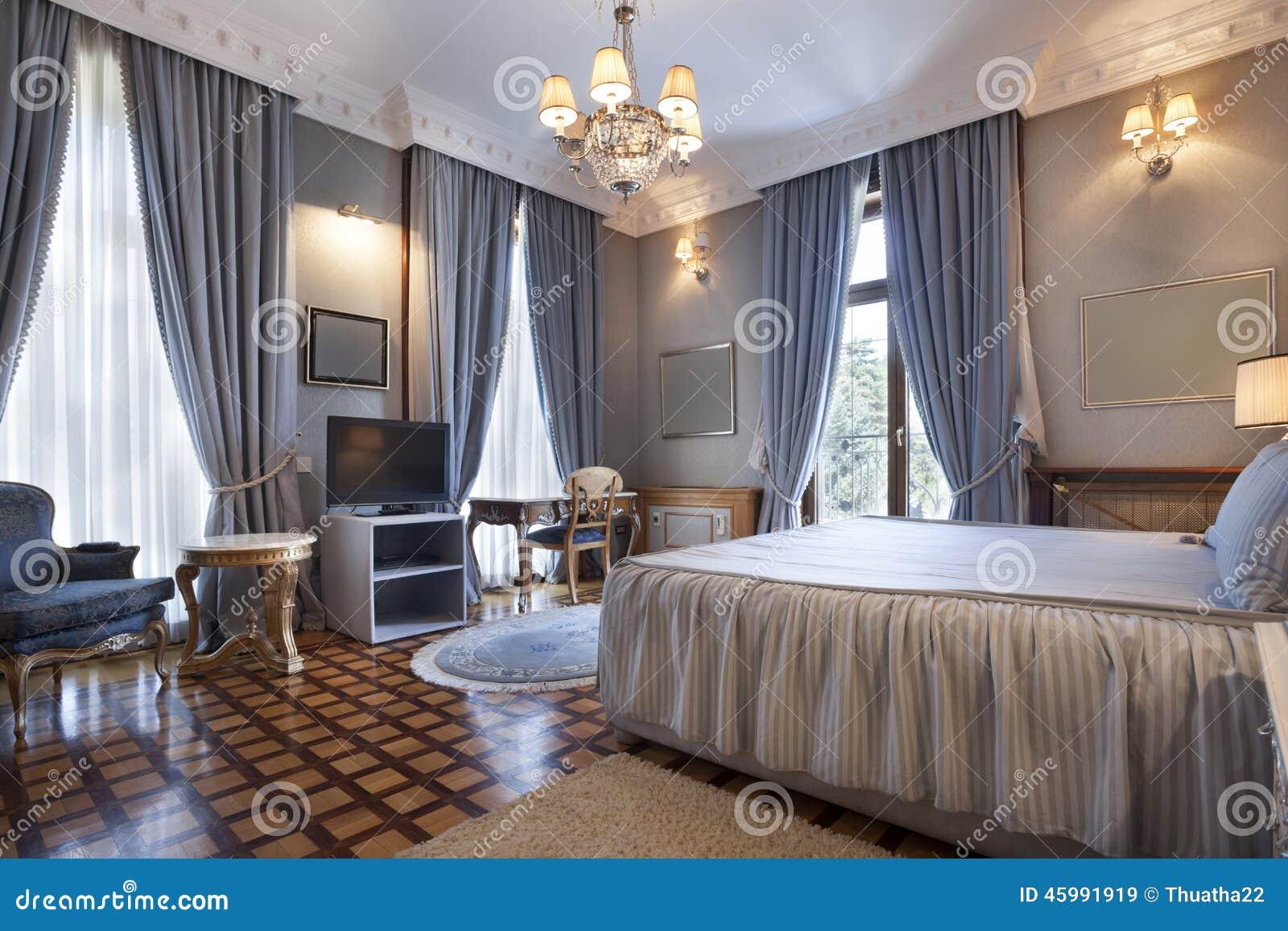 https://thumbs.dreamstime.com/z/interior-de-um-quarto-cl%C3%A1ssico-do-estilo-na-casa-de-campo-luxuosa-45991919.jpg