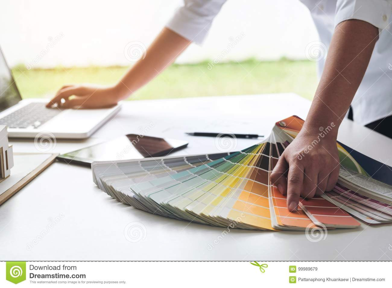 interior design or graphic designer working on project of architecture drawing with work tools and color swatches, colour chart i