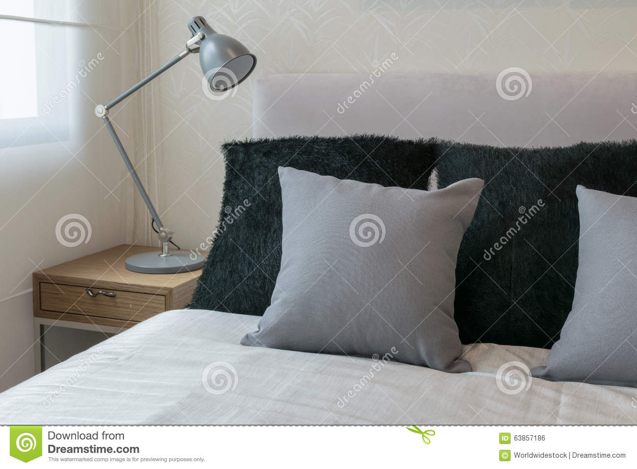 Interior Design With Grey Pillows On White Bed Stock Photo