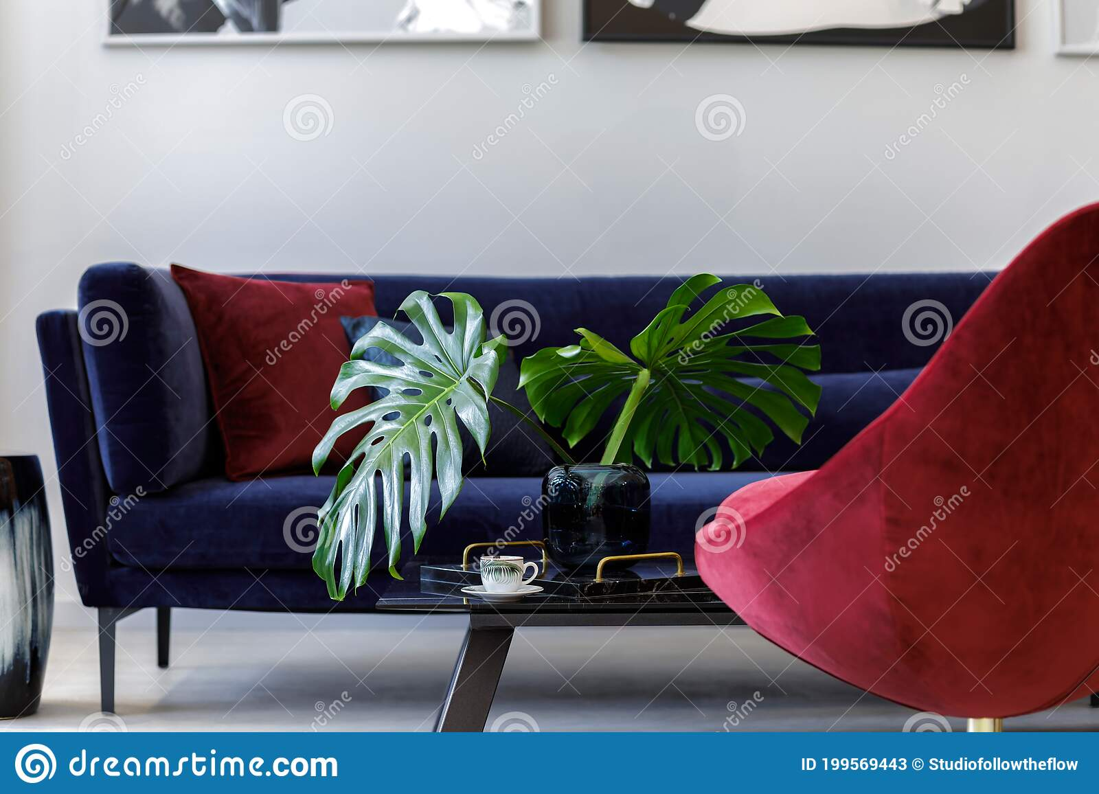 Interior Design Of Living Room With Blue Velvet Sofa Red Armchair Paintings Design Vase Table Decoration Stock Image Image Of Interior Design 199569443
