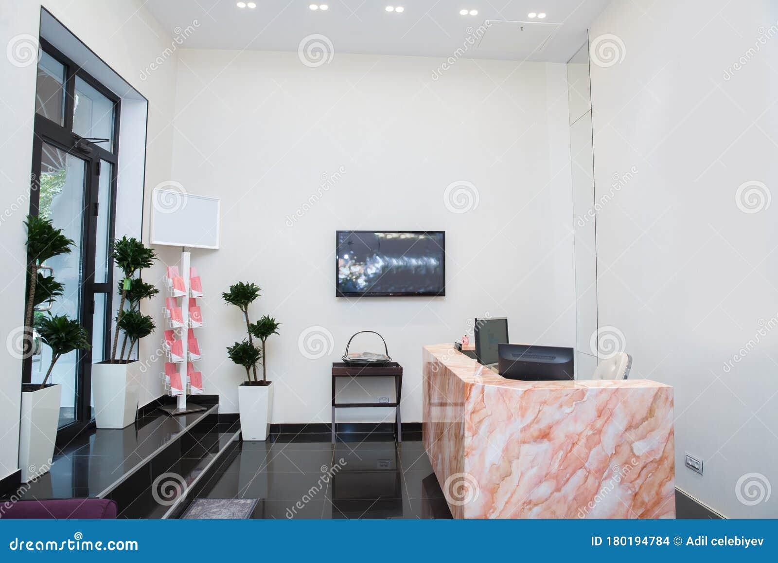 Interior Design Reception Of A Bright Beauty Salon Reception Area At The Beauty Salon Red Marble Reception Glass Door Editorial Stock Image Image Of Indoor Banner 180194784