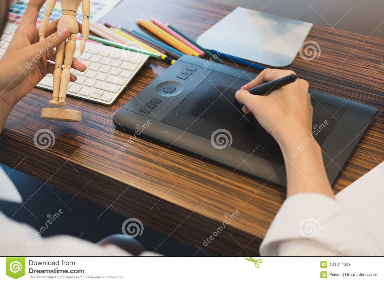 Interior designer drawing on graphic tablet at office artist wo stock image image 101817609 for Best tablet for interior designers