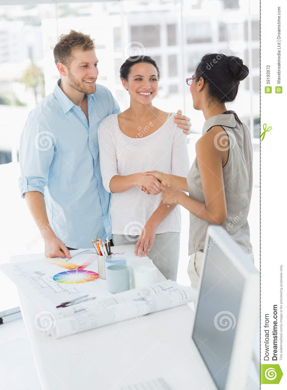 Interior designer shaking hands with smiling client stock for How to find interior design clients