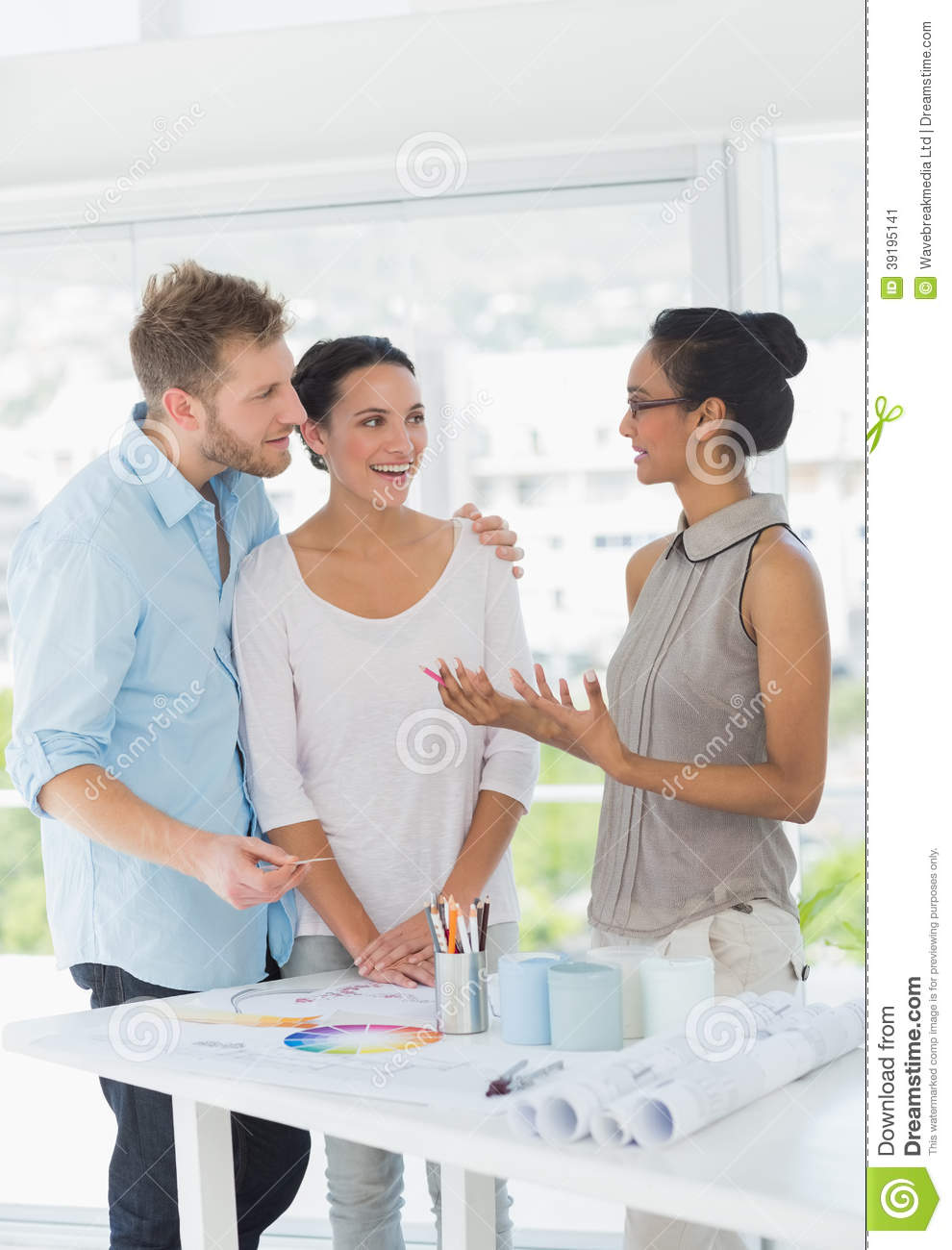 Interior designer speaking with happy clients stock image for How to find interior design clients