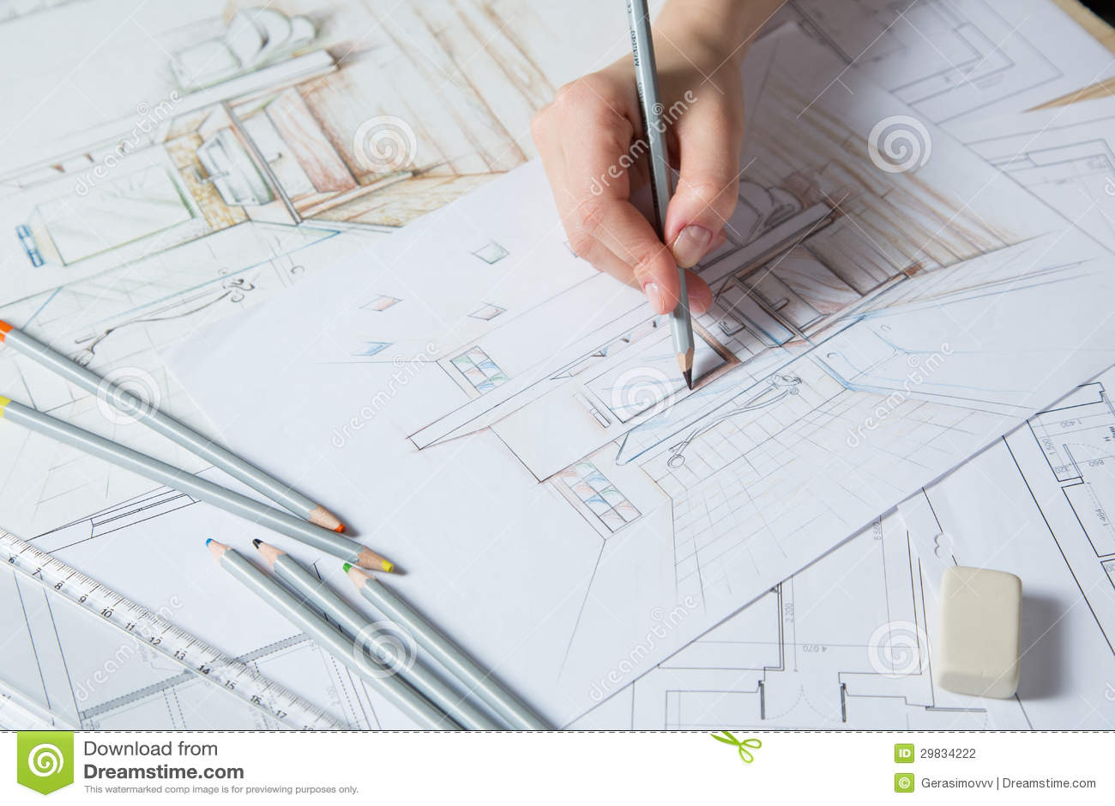 interior designer works on a hand drawing sketch using color pencils