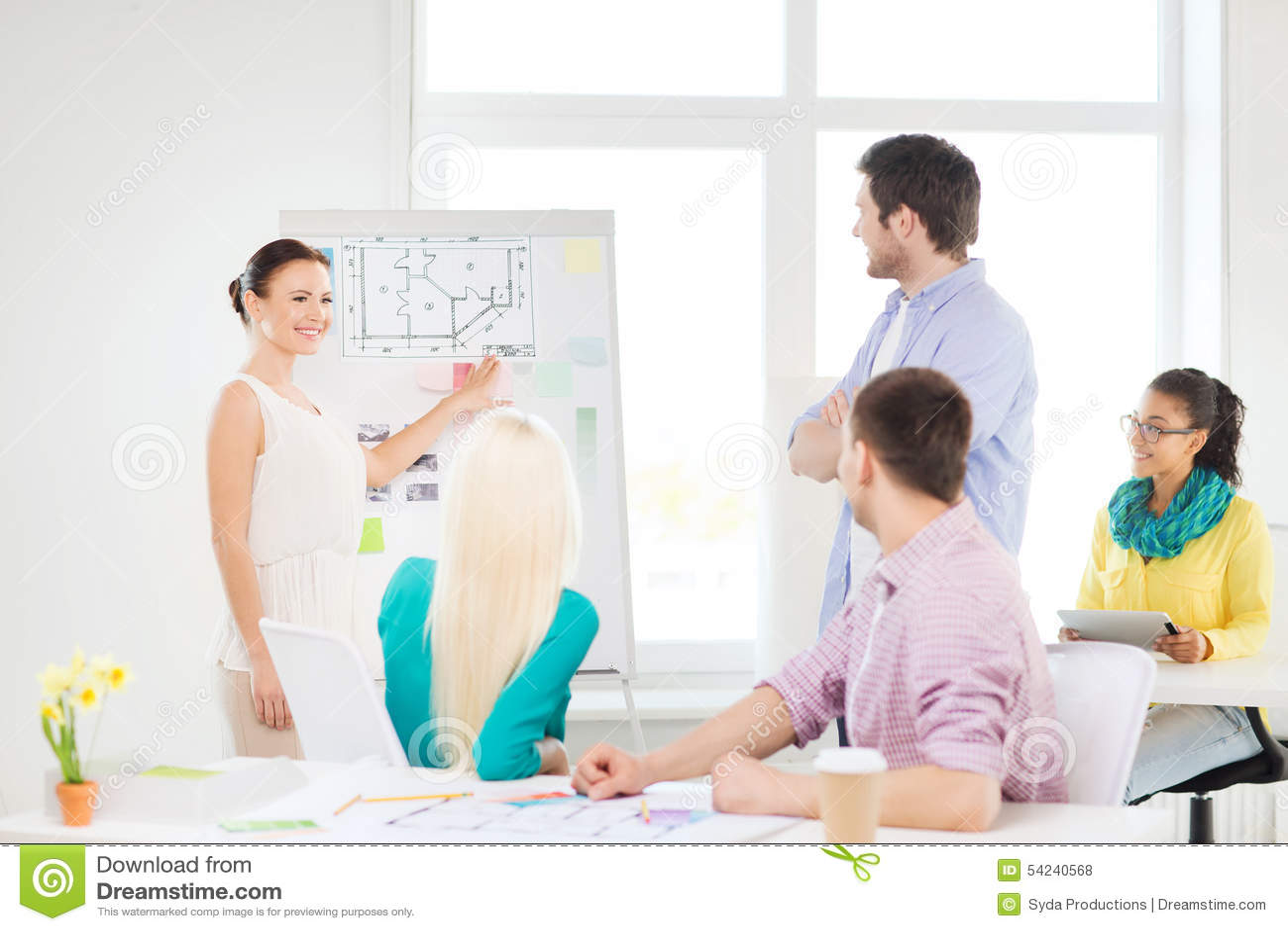 Interior designers having meeting in office stock for Interior designer education