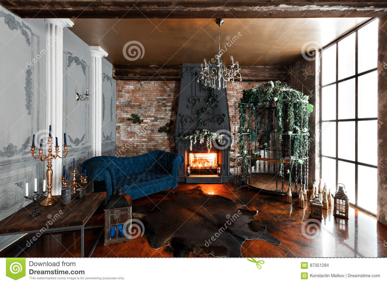 Interior with fireplace, candles, skin of cows, brick wall, large window and a metal cell of a loft, living room, coffee