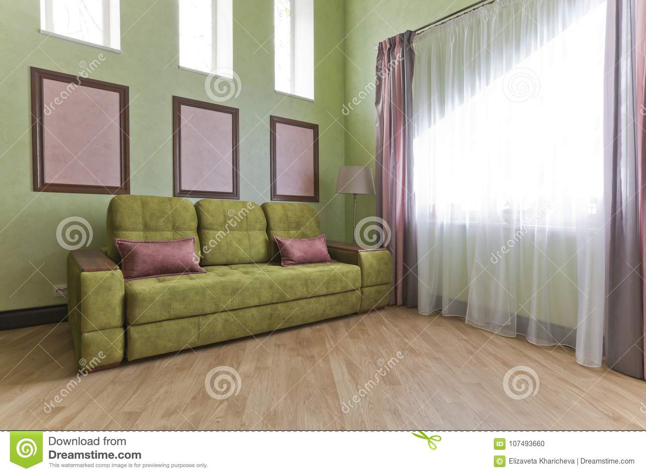 Interior In Green And Pink Colors With Green Sofa And Light Parquet