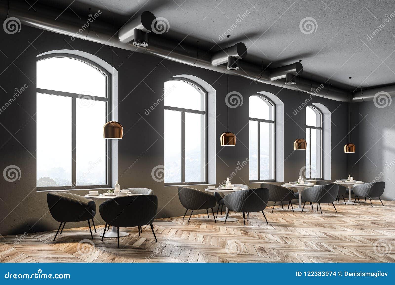 305ec2407921 Esquina moderna del restaurante con las paredes grises, las ventanas  arqueadas, un piso de madera y las mesas redondas con las butacas mofa de  la ...