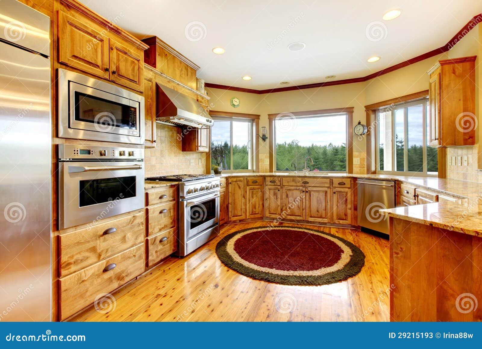 Interior home luxuoso de madeira da cozinha. HOME nova do americano da  #B34905 1300 957