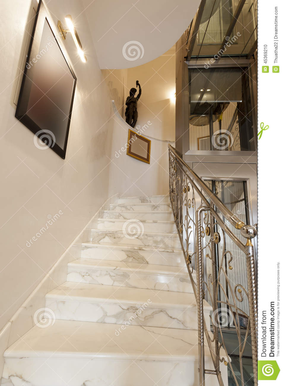 interior of hotel with marble staircase and banisters stock photo