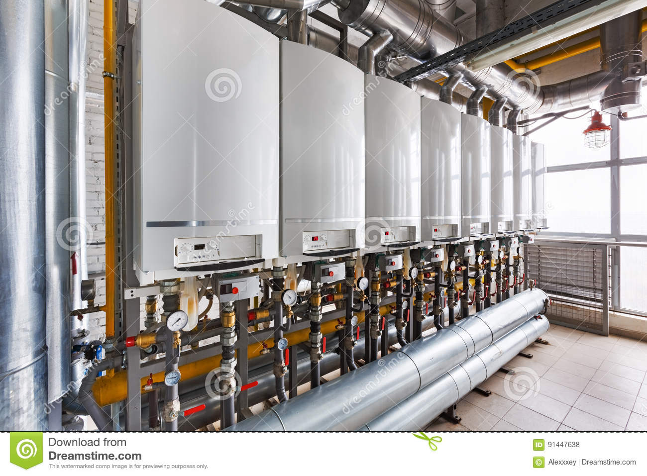 Interior of industrial, gas boiler house with a lot of boilers a