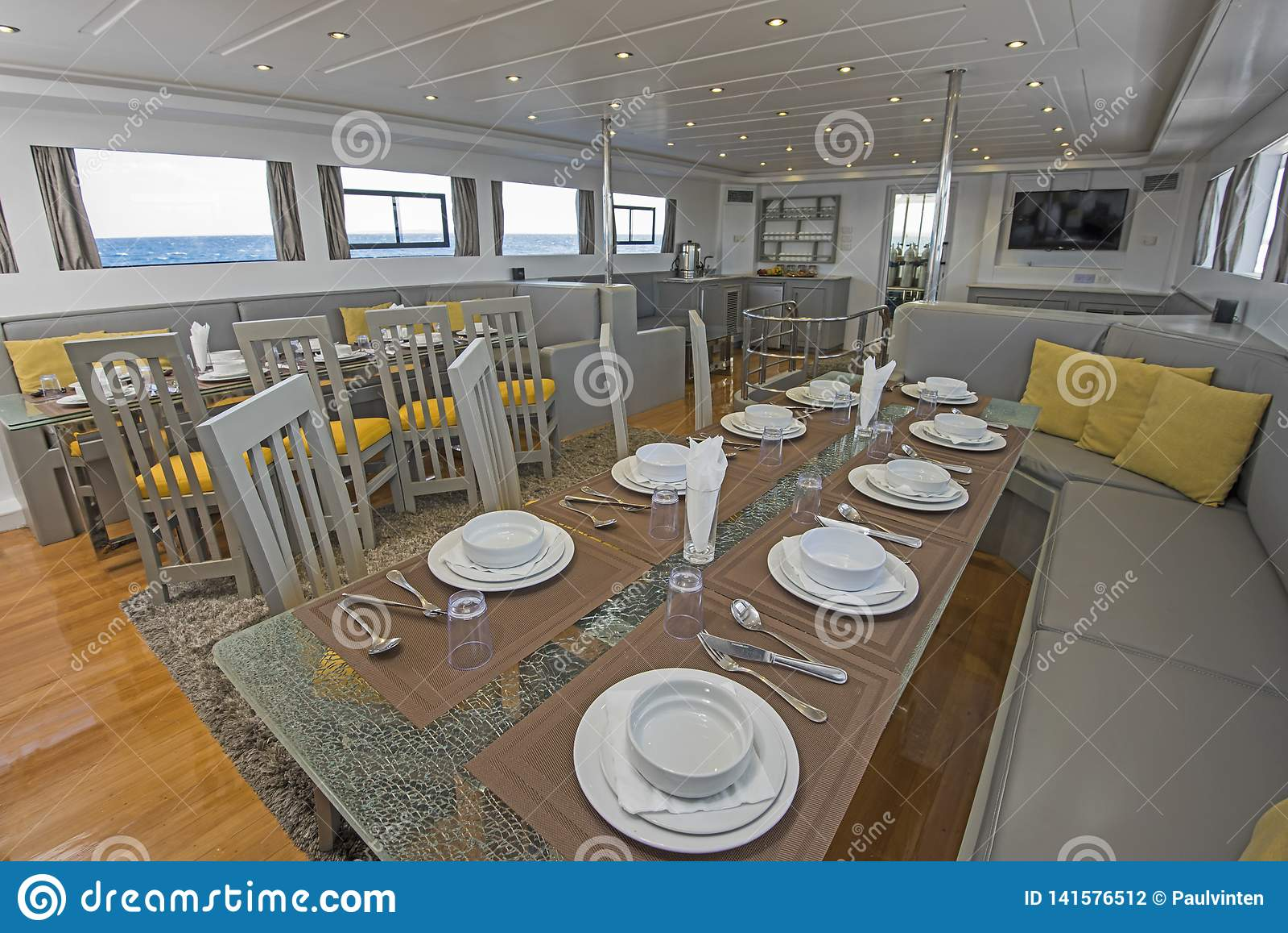Interior Of Large Salon Dining Area Of Luxury Motor Yacht