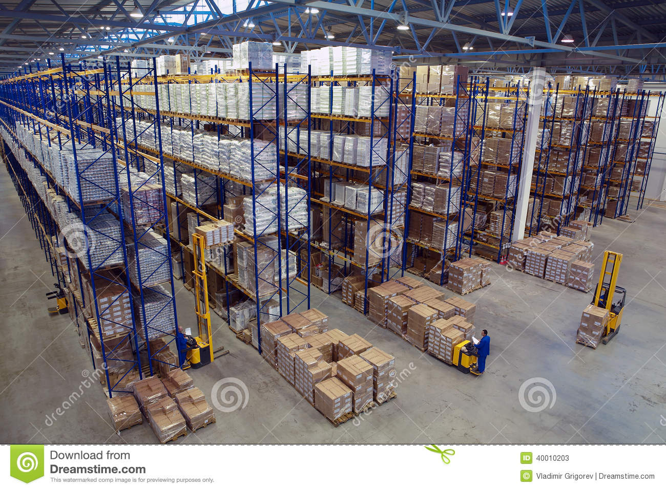 Interior Large Warehouse With Freight Stacked High