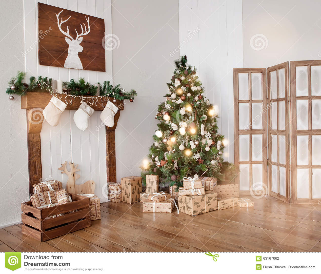 interior living room with a christmas tree and gifts  stock photo