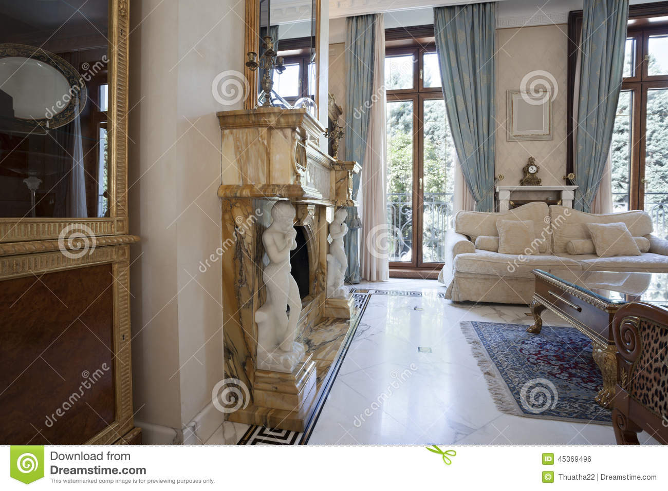 Interior of a living room with fireplace in luxury villa