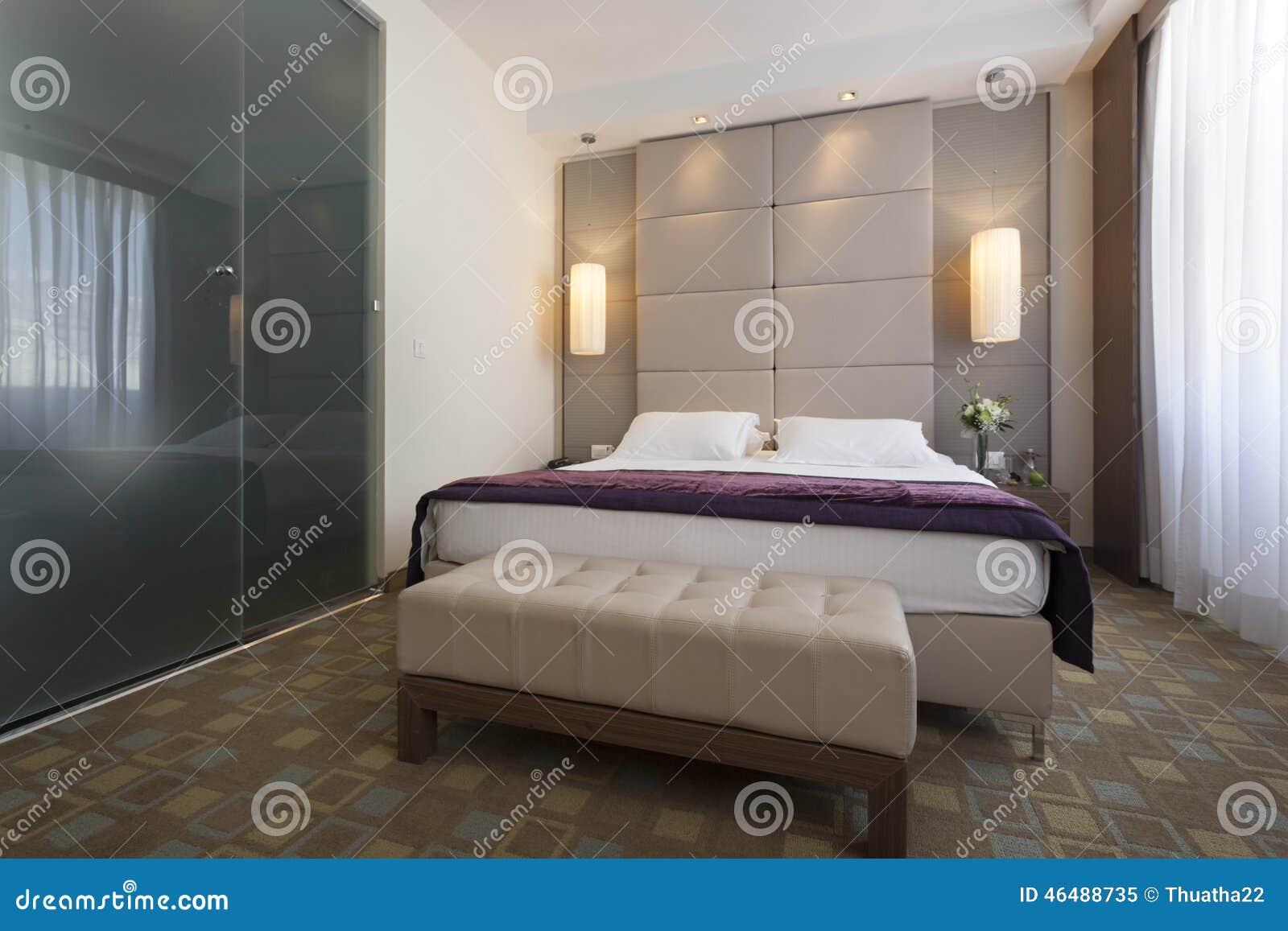 Interior of a luxury hotel bedroom with bathroom stock for Salle de bain hotel