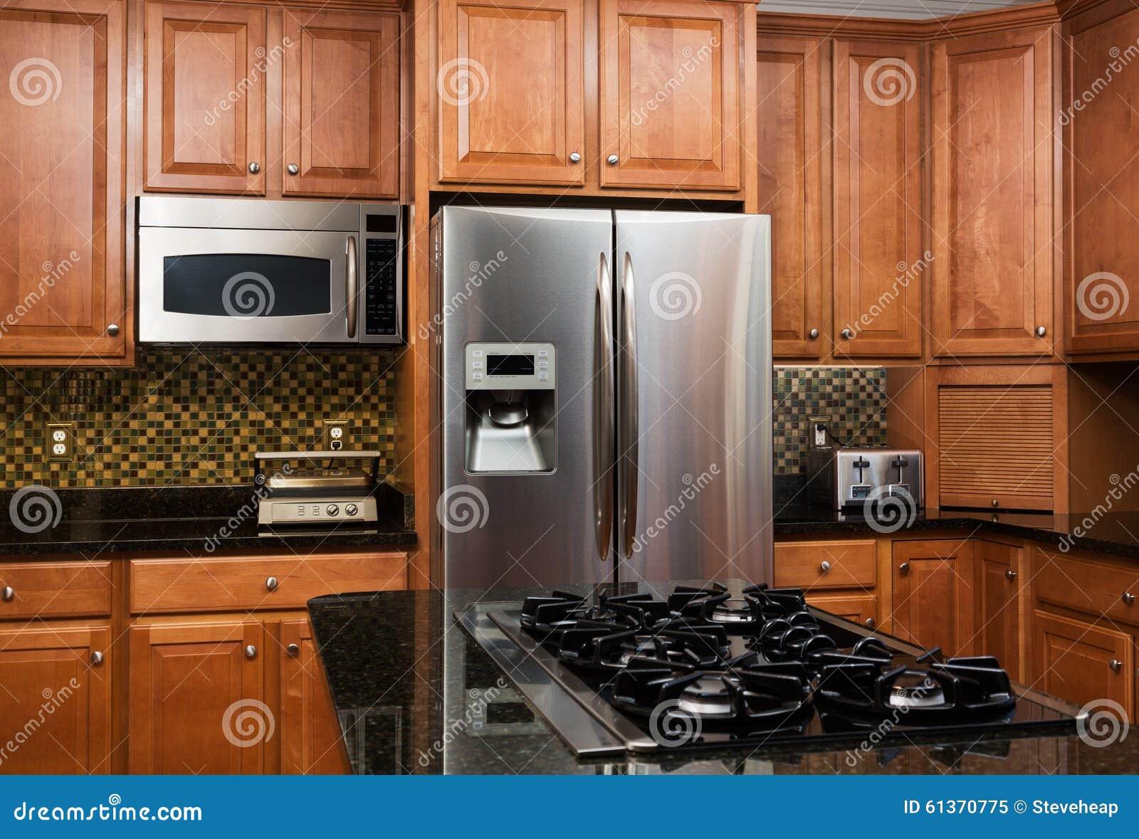 Kitchen Hob Side View ~ Interior of luxury kitchen in modern home stock photo