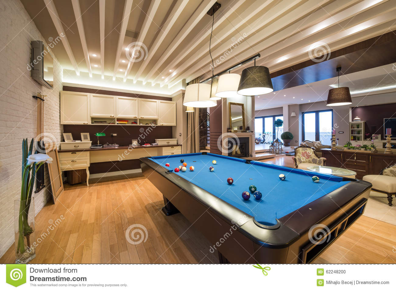 Interior Of A Luxury Living Room With Pool Table. Lights, Furniture.
