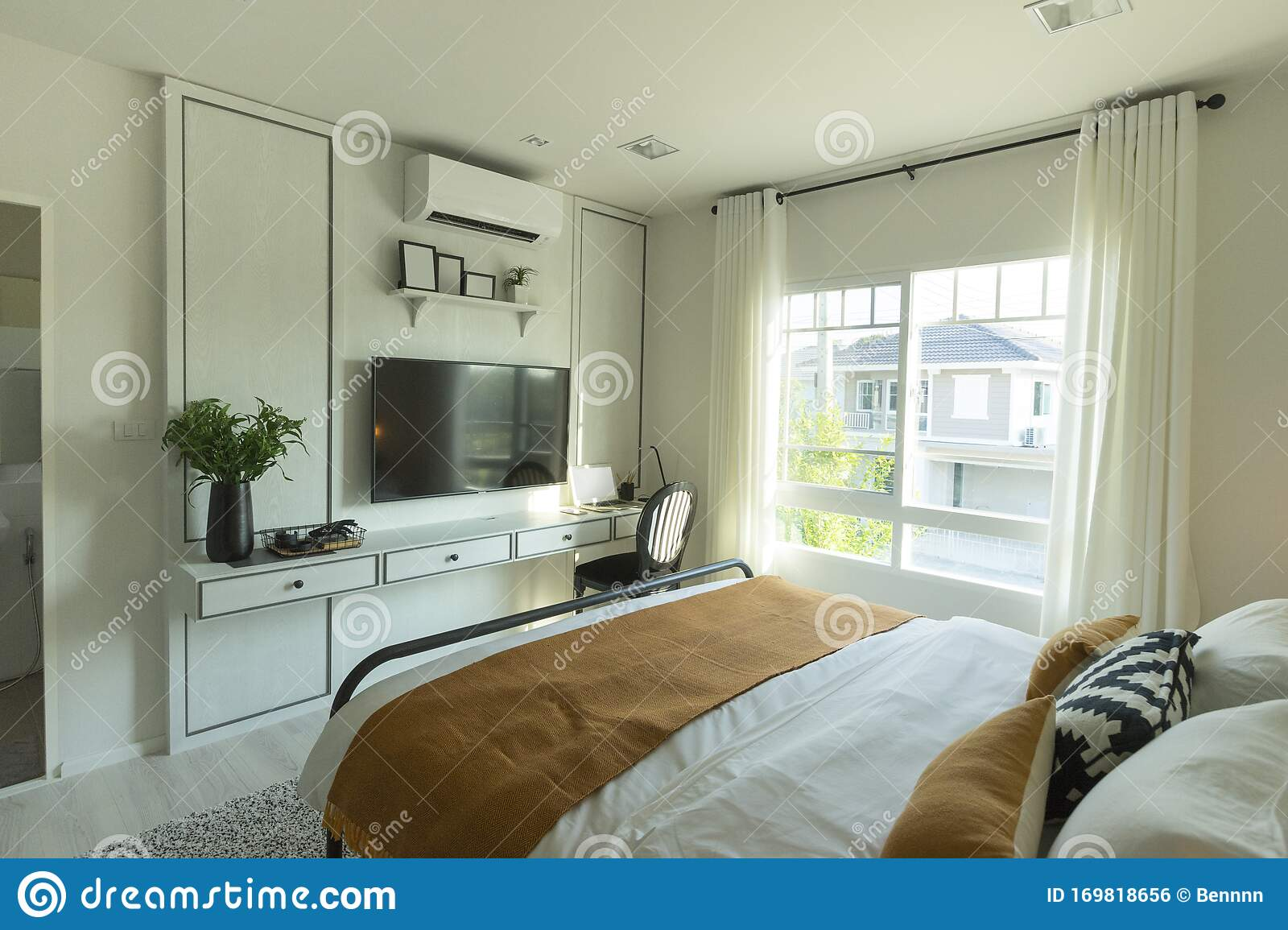 Interior Of Master Bedroom With Window And Big Tv On The Wall Stock Photo Image Of Modern House 169818656