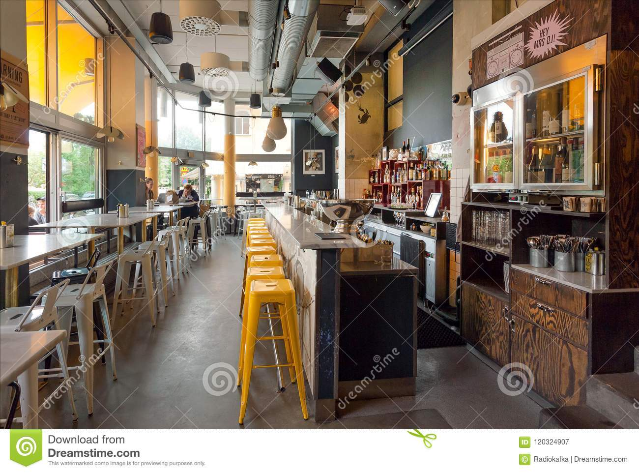 Stockholm sweden jun 15 2018 interior of the modern cafe with bar counter and many bottles with alcohol on june 15 2018 sweden with 105 million
