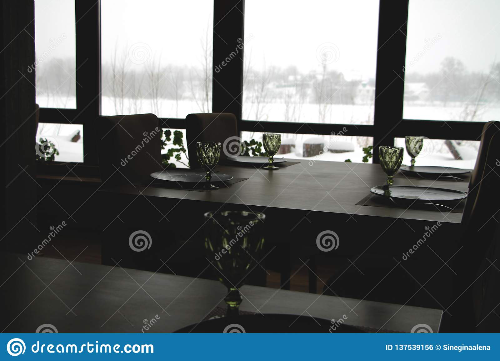 Interior of a modern country restaurant. View of the winter landscape