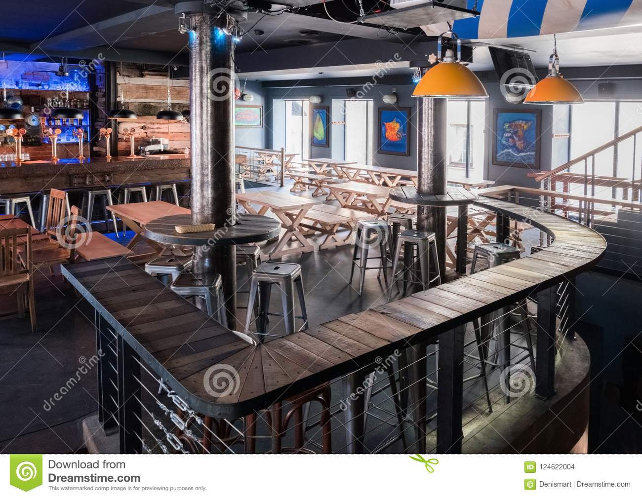 Interior Of Modern European Beer Bar Pub With Old Vintage Retro Wooden  Furniture And Style.