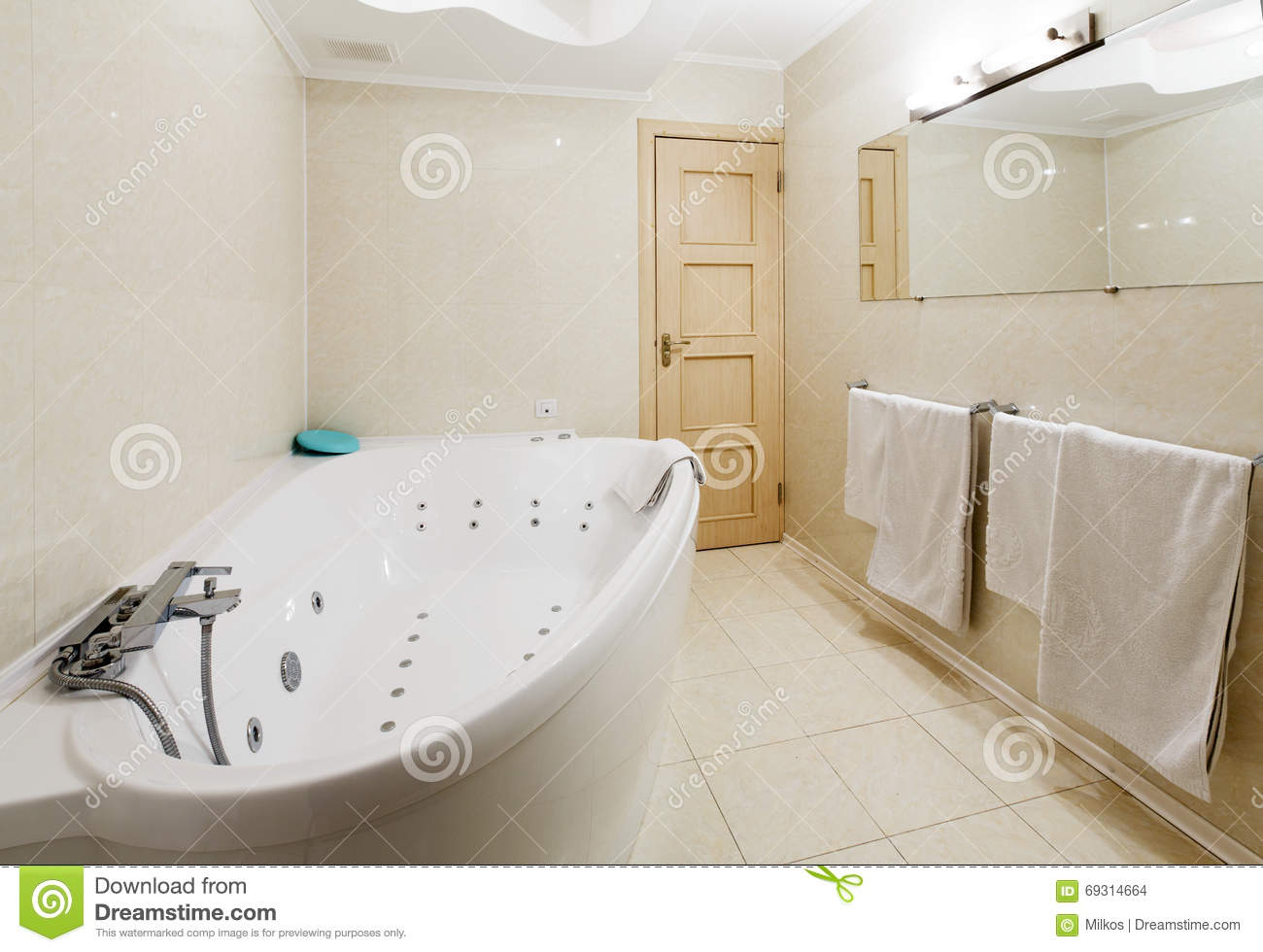 Interior of a modern hotel bathroom jacuzzi stock photo image