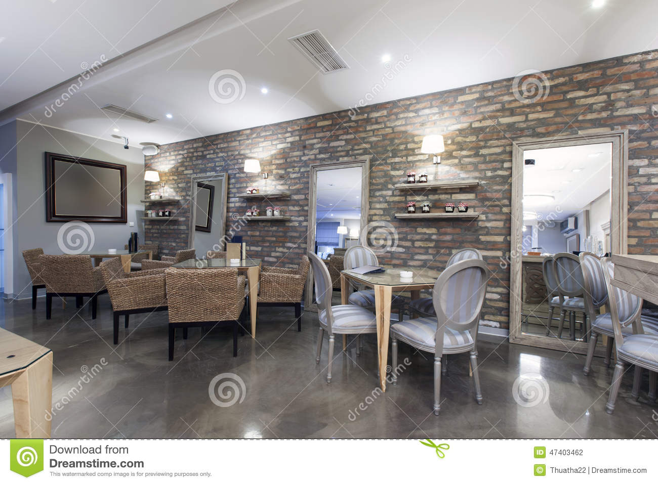 interior of a modern hotel cafe with stone wall stock. Black Bedroom Furniture Sets. Home Design Ideas