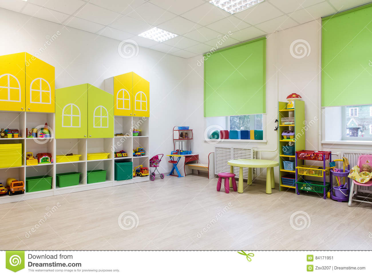 Interior of a modern kindergarten in yellow and green colors. stock