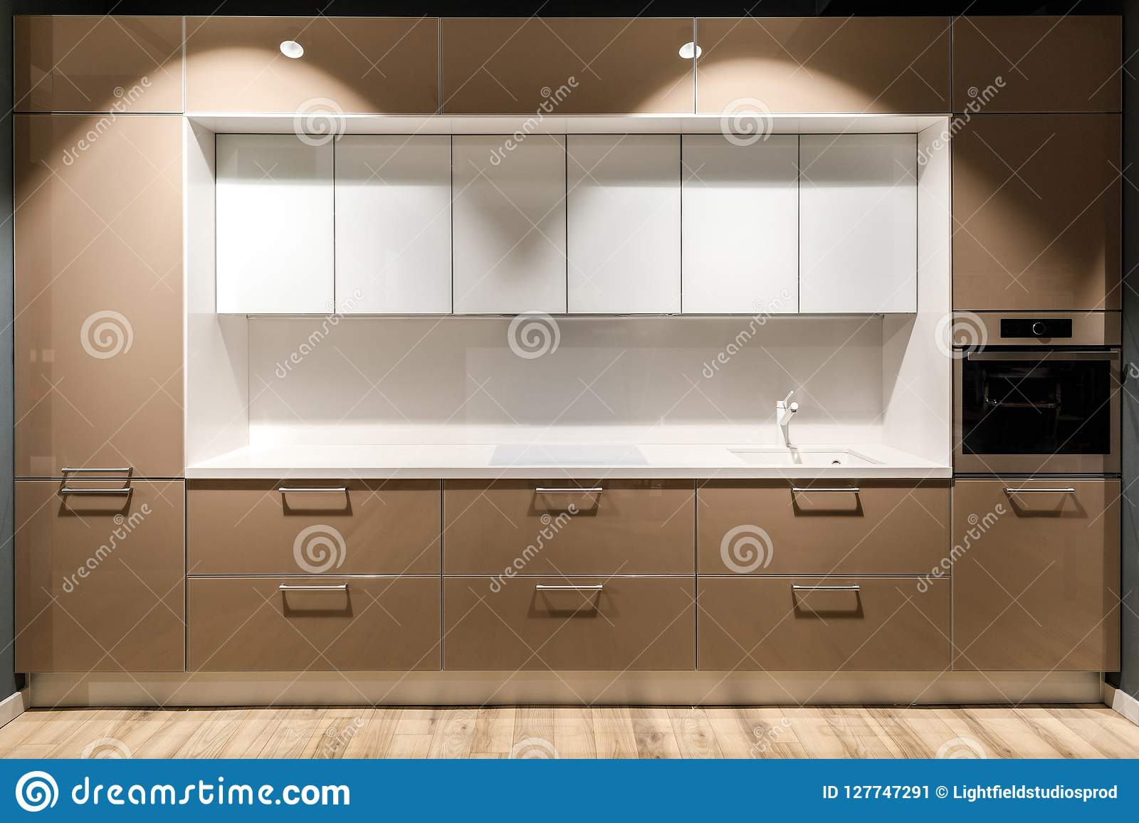 Interior Of Modern Kitchen With Stylish Design In Brown And