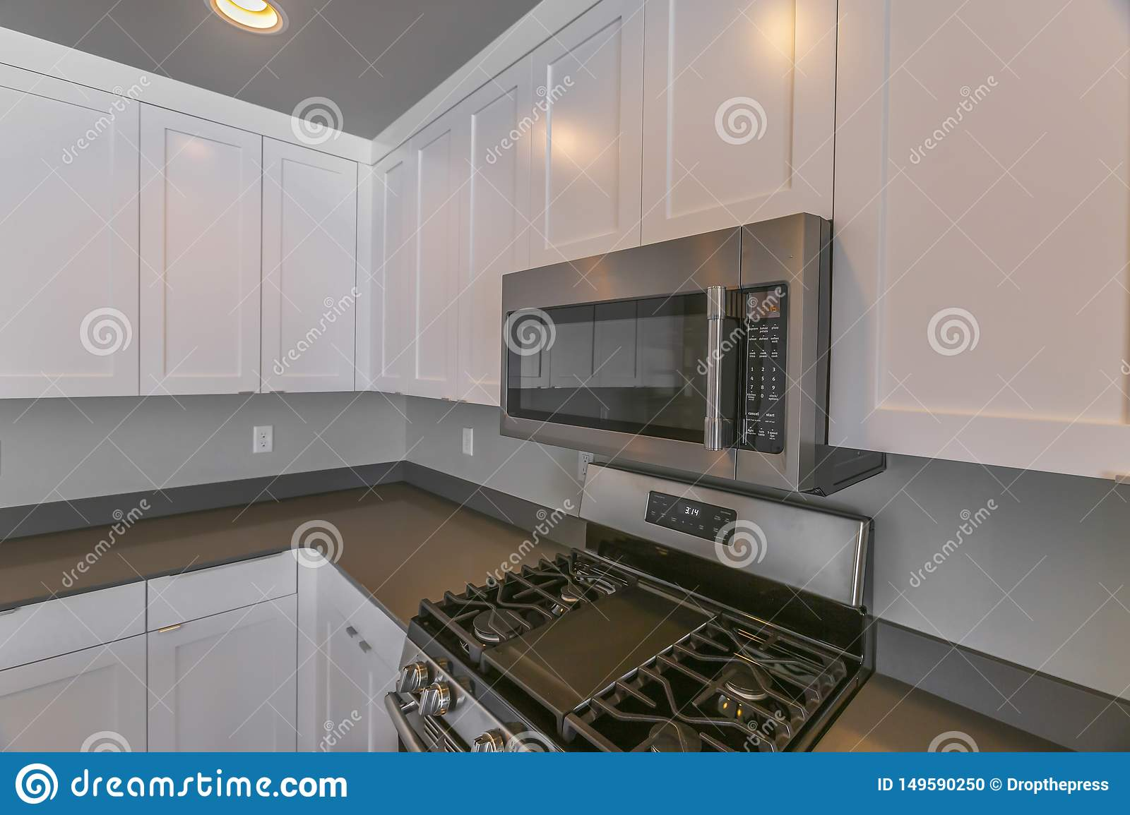 Interior Of A Modern Kitchen With Wooden Cabinets And Round Ceiling Lights Stock Photo Image Of Interior Oven 149590250
